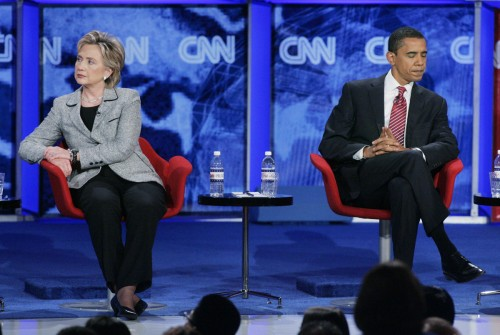 U.S. Senators Clinto and Obama sit onstage during Democratic Party debate at the University of Nevada Las Vegas (UNLV) in Las Vegas