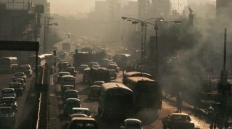 ca. 1986, Delegacion Miguel Hidalgo, Mexico City, Mexico --- A major street in the Miguel Hidalgo area of Mexico City is clogged with traffic and smog during the morning rush hour. --- Image by © Stephanie Maze/CORBIS
